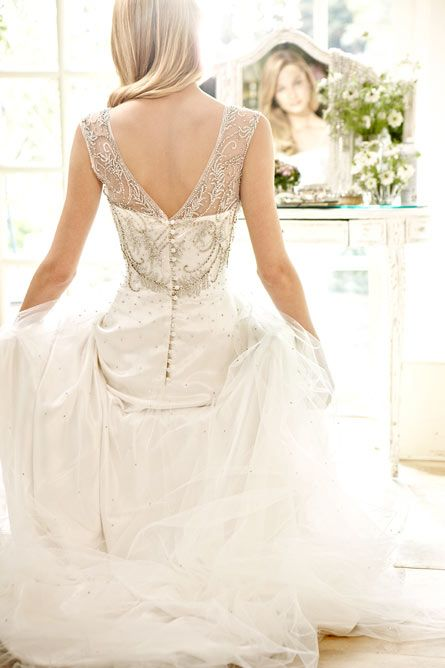 These days, you are safe to stray from a bleach-white dress. This off white is nice, and the detailing is to die for!