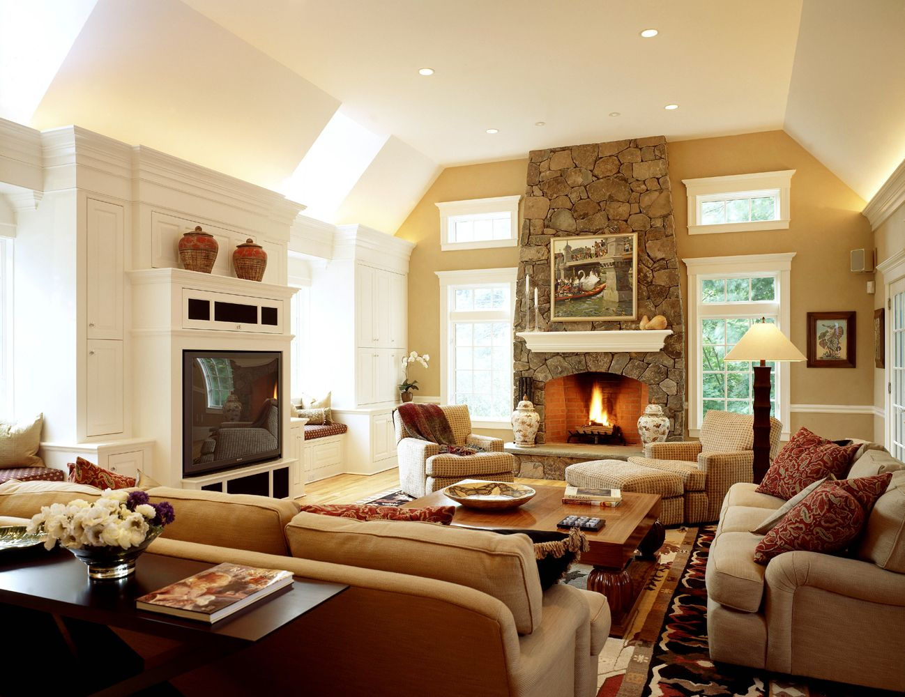 Love the stone rounded fireplace and windows on both side for Fireplace with windows on each side
