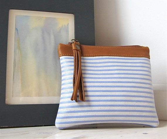 Leather  zipper pouch/ bag organizer / cosmetic bag  in lavender blue and white stripes with tan finishing. €22,00, via Etsy.