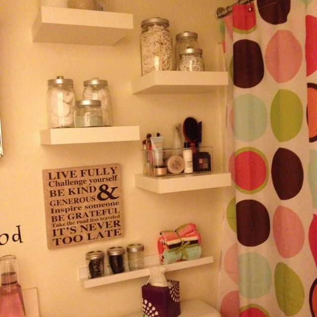 Not the best picture, but I finally added some shelving to give me more storage space in my tiny bathroom!! :)