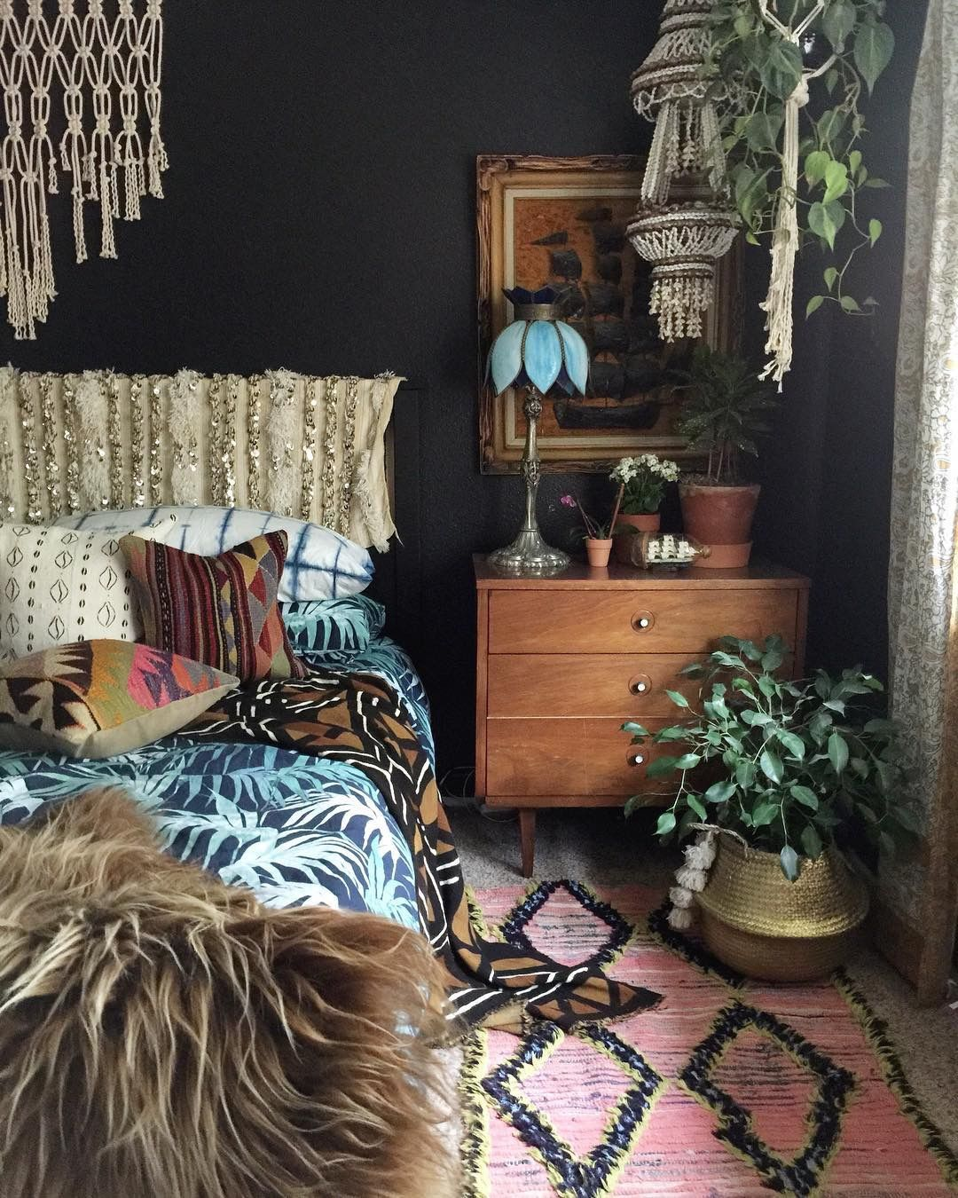 I love the dark wall and the wrapped headboard. Maybe watch for a fancy full-sized throw blanket.
