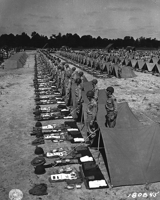 The layout | Company F, 347th Inf Reg., 87th Inf. Division, stands by for inspection by the Commanding General, Major General Percy Clarkson on May 8, 1943) Signal Corps Photo by Sgt. J. A. Grant