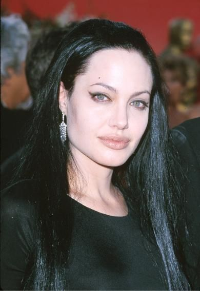 """For her """"Girl Interrupted"""" best supporting actress win, Jolie conjured up  Morticia Addams with fair skin and jet black hair. 6da944dbbc"""
