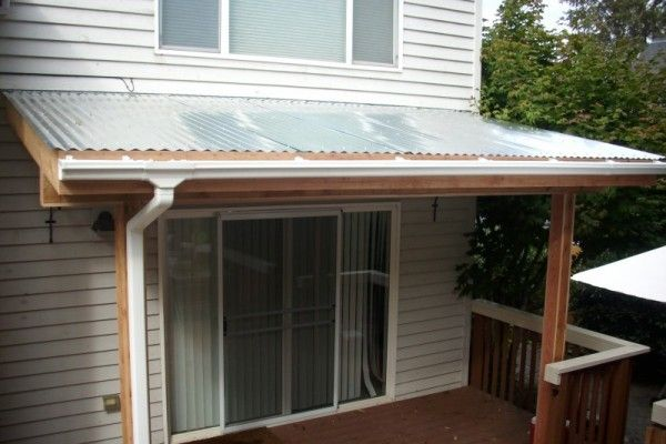 Corrugated patio cover, gutter, cedar-wrapped posts | Yard