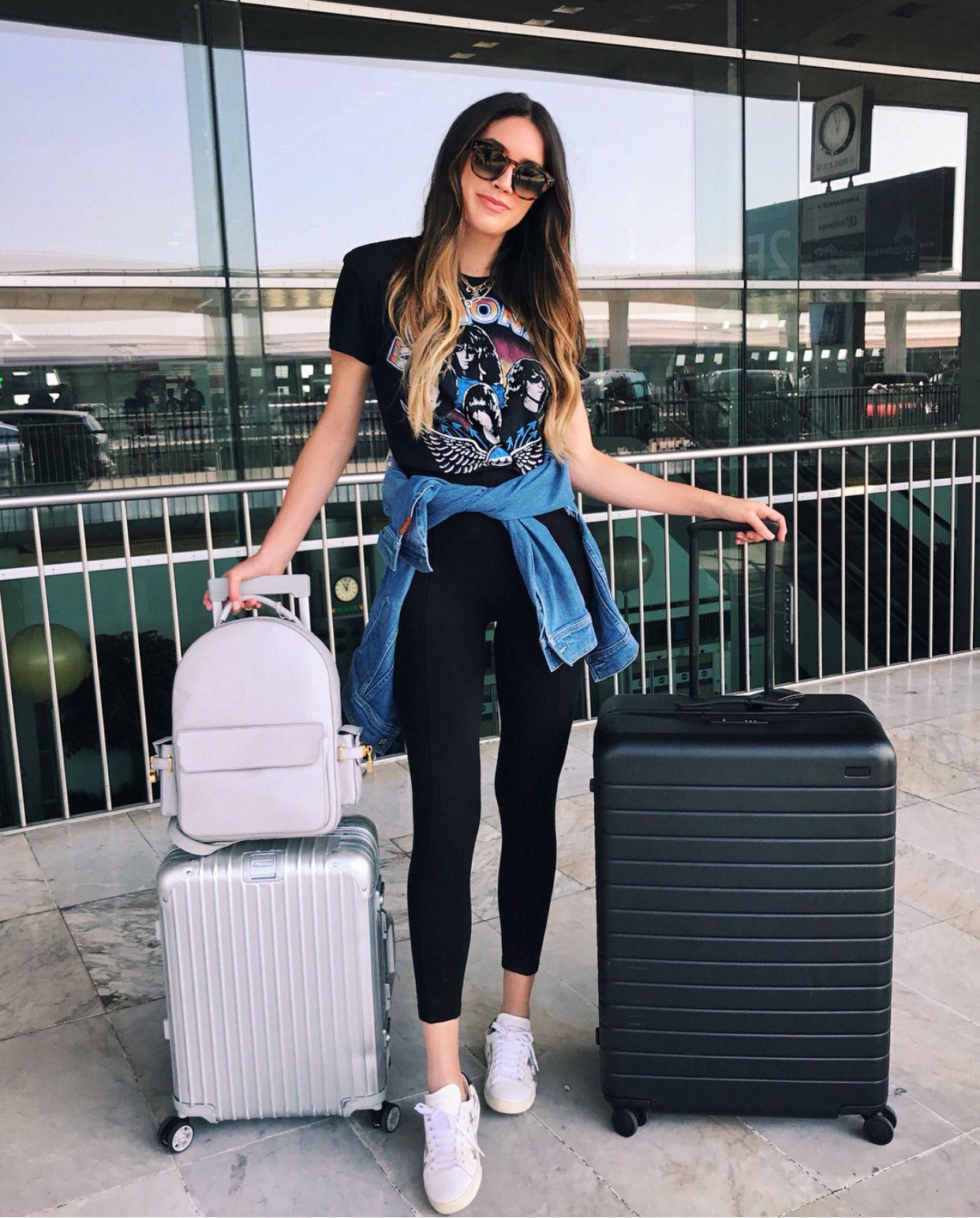 4422582992f9 Black rock-band t-shirt+black leggins+white sneakers+grey backpacks+denim  jacket+sunglasses+silver suitcase+black suitcase. Summer Travel Outfit 2017
