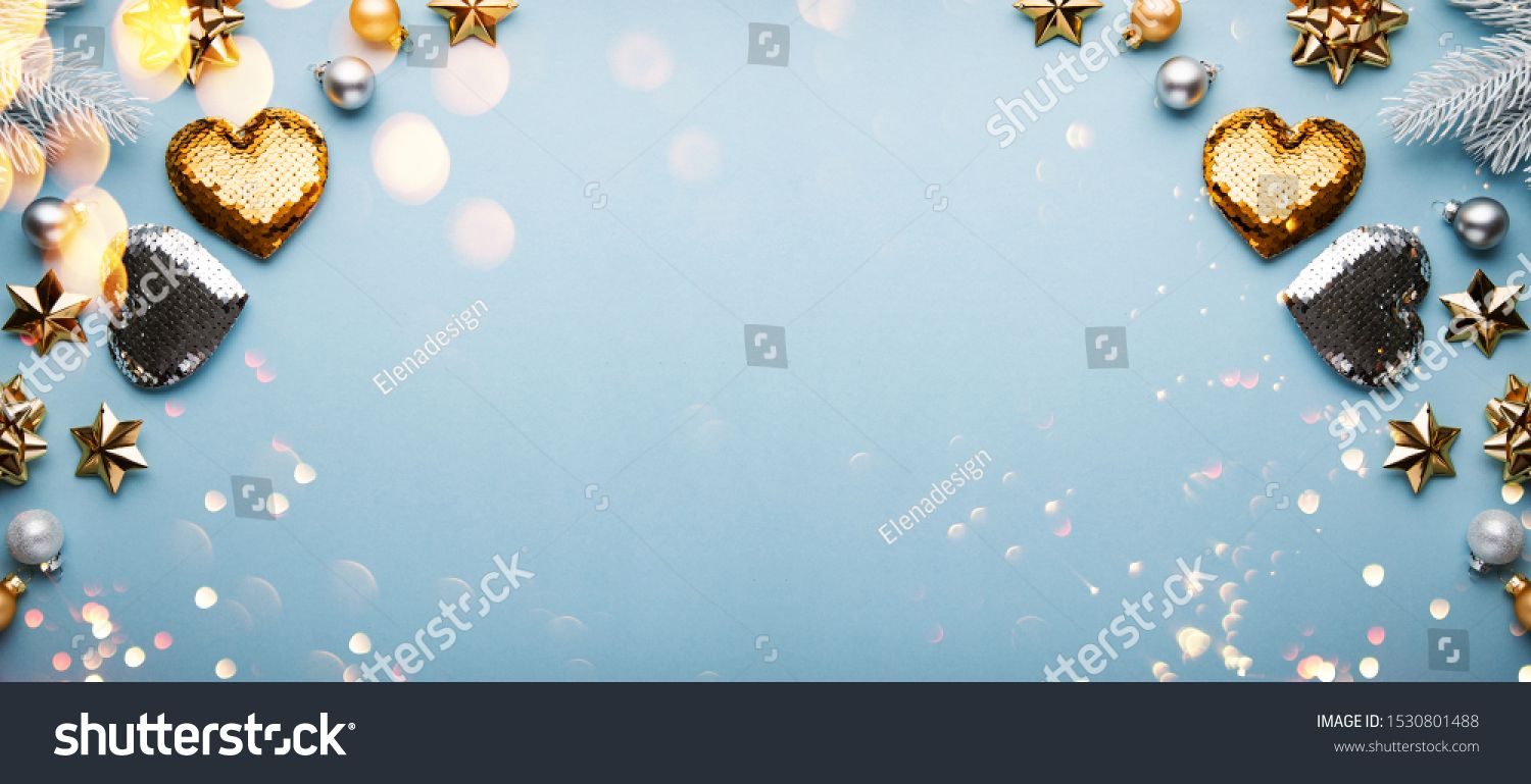 Merry Christmas and Happy Holidays greeting card frame banner New Year Noel Christmas white silver and golden ornaments on blue background top view Winter xmas holiday th...