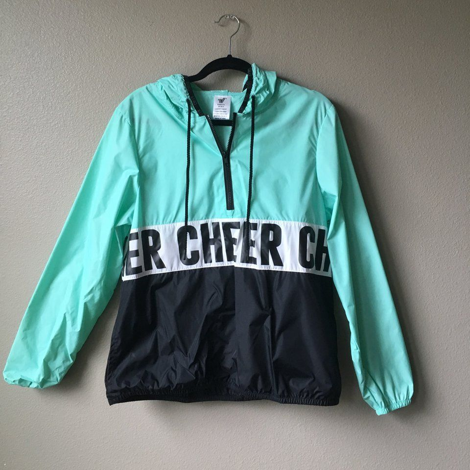 8abf7c39 Blue and black cheer rain jacket!! Never worn and in perfect condition!!  Elastic wrist and waist. Lining or hoodie says cheer all around! - Depop