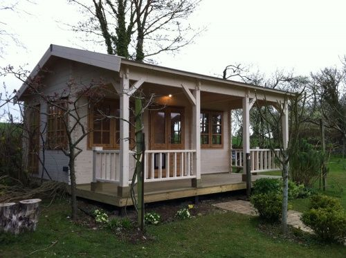 Log Cabin With Veranda Used As A Garden Office