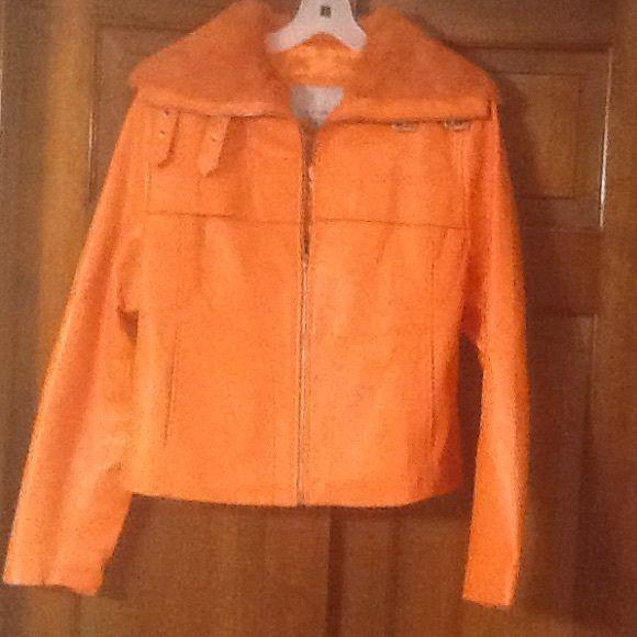 Wilson leather jacket Orange genuine leather jacket with rabbit fur collar. Never worn Wilsons Leather Jackets & Coats