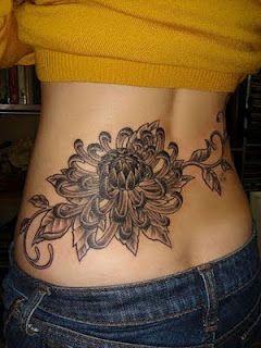 black flower tattoo and vine design for women
