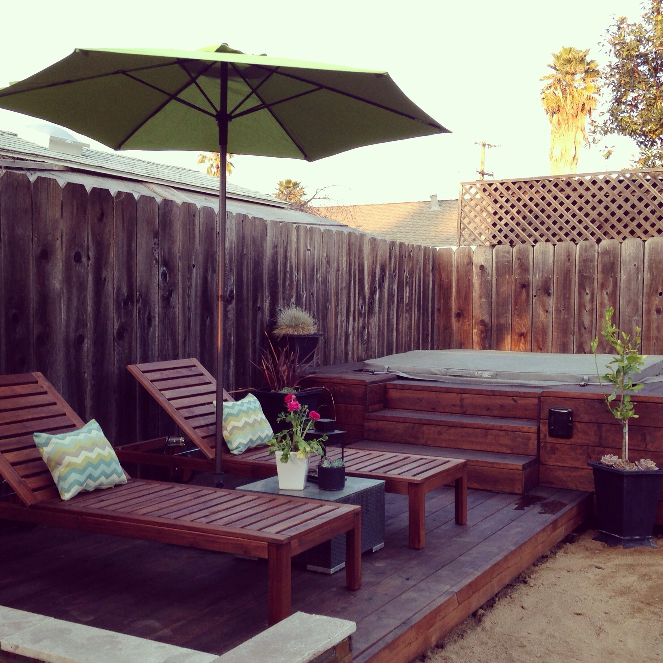 Ikea lounge chairs, Home Depot Pear Umbrella, stained deck