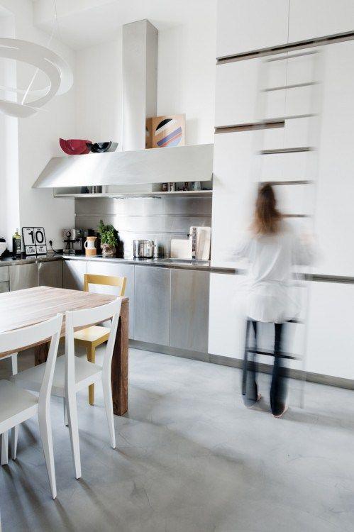 small apartment - loft - white - gray - concrete floor - resin floor - steel kitchen - professional kitchen - artemide - livia chair - gio ponti -  attic stair - vertical stair -
