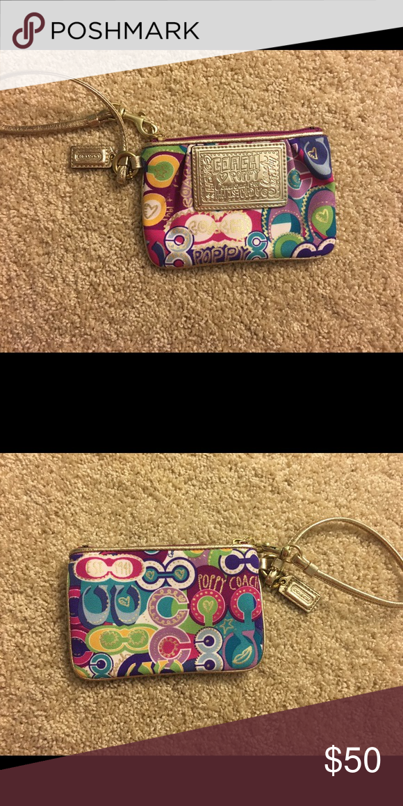 Coach wristlet Perfect condition. Never used. Coach Bags Clutches & Wristlets