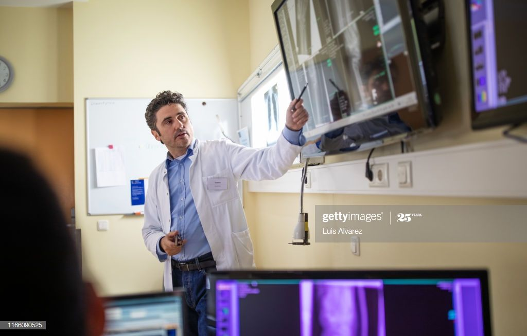 Doctors Discussing Over Xray Reports On A Digital Display Photography #Ad, , #spon, #Xray, #Discussing, #Doctors, #Reports