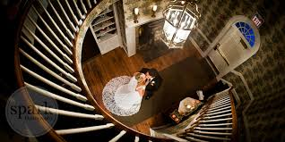 Such an awesome and unique photo! #themanorhouseatcommonwealth #staircase #unique #kiss #couple #bride #groom #foyer #farmhouse