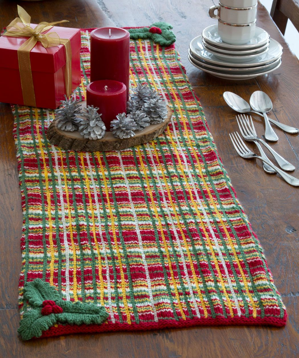 Holiday table runner free knitting pattern from red heart yarns holly and berries stripe crochet table runner pattern for 2014 christmas wooden holder pine cones red candles tableware set bankloansurffo Images