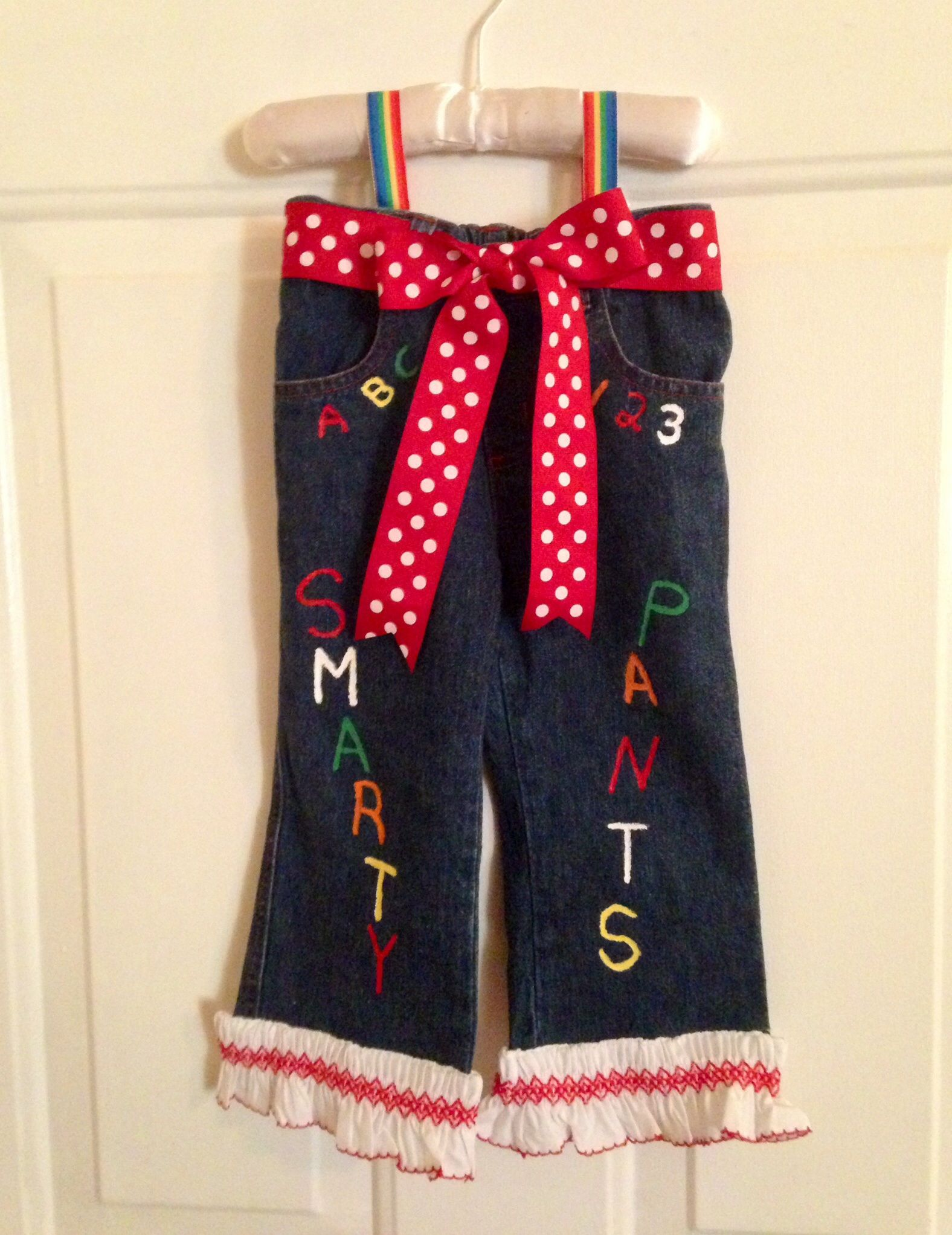 Even if you can't sew, use old pants, glue and fabric paint to create these adorable Smarty Pants.  I didn't have to purchase anything, made with supplies on hand.  These are sewn together, but could easily be glued or stitch witchery.