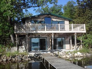 Lake House With A Pontoon Boat Homeaway Wisconsin Dells Lake House Rentals Vacation Home Rentals Lake Cabins We accept cash, check , and charge visa/mastercard/discover/americanexpress one night rental required for deposit at the time reservation is made. lake house with a pontoon boat