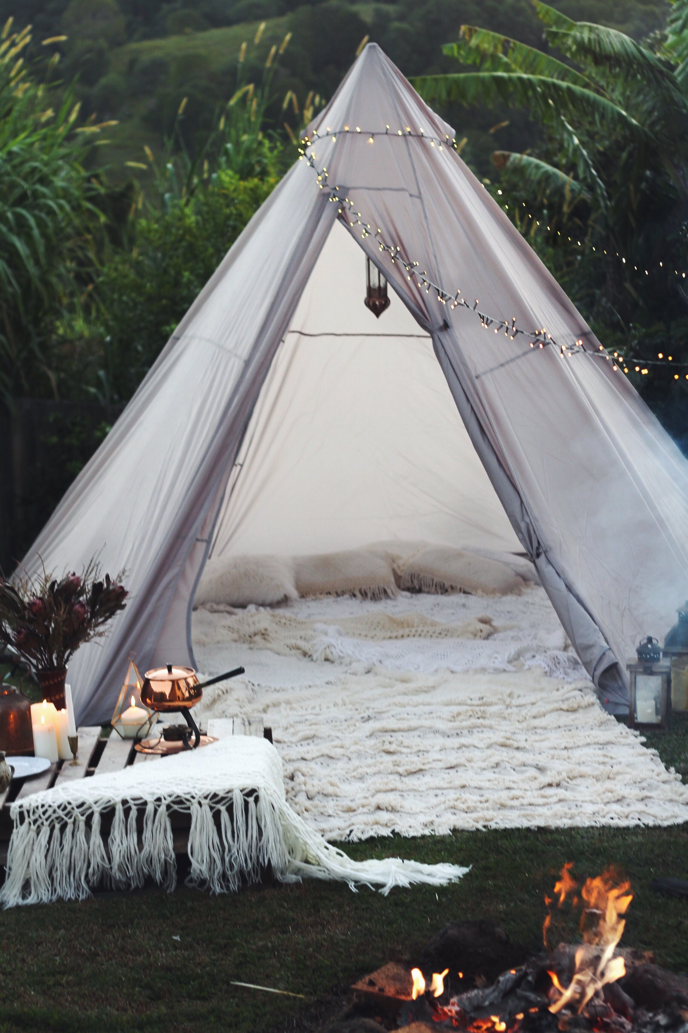 Glamping. Boho bohemian style camp out in the backyard. Moroccan ...