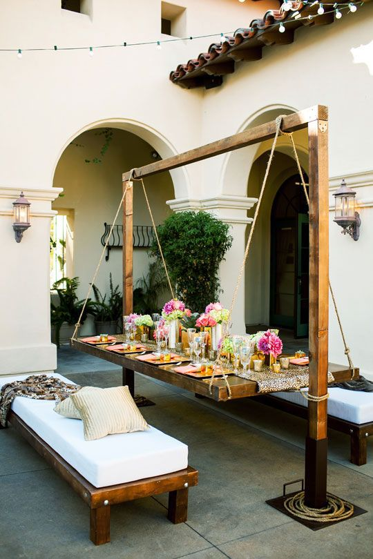 A hanging table is not only durable outdoor furniture but make for one  unique tablescape