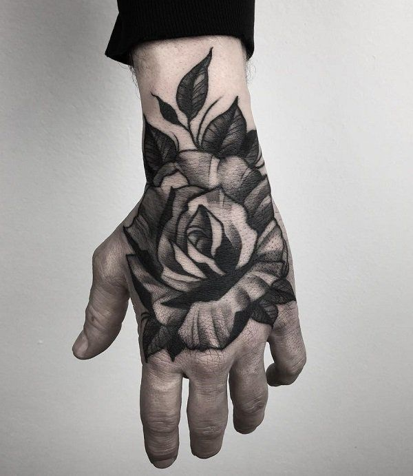 60 Eye Catching Tattoos On Hand Cuded Rose Hand Tattoo Hand Tattoos For Guys Hand Tattoos
