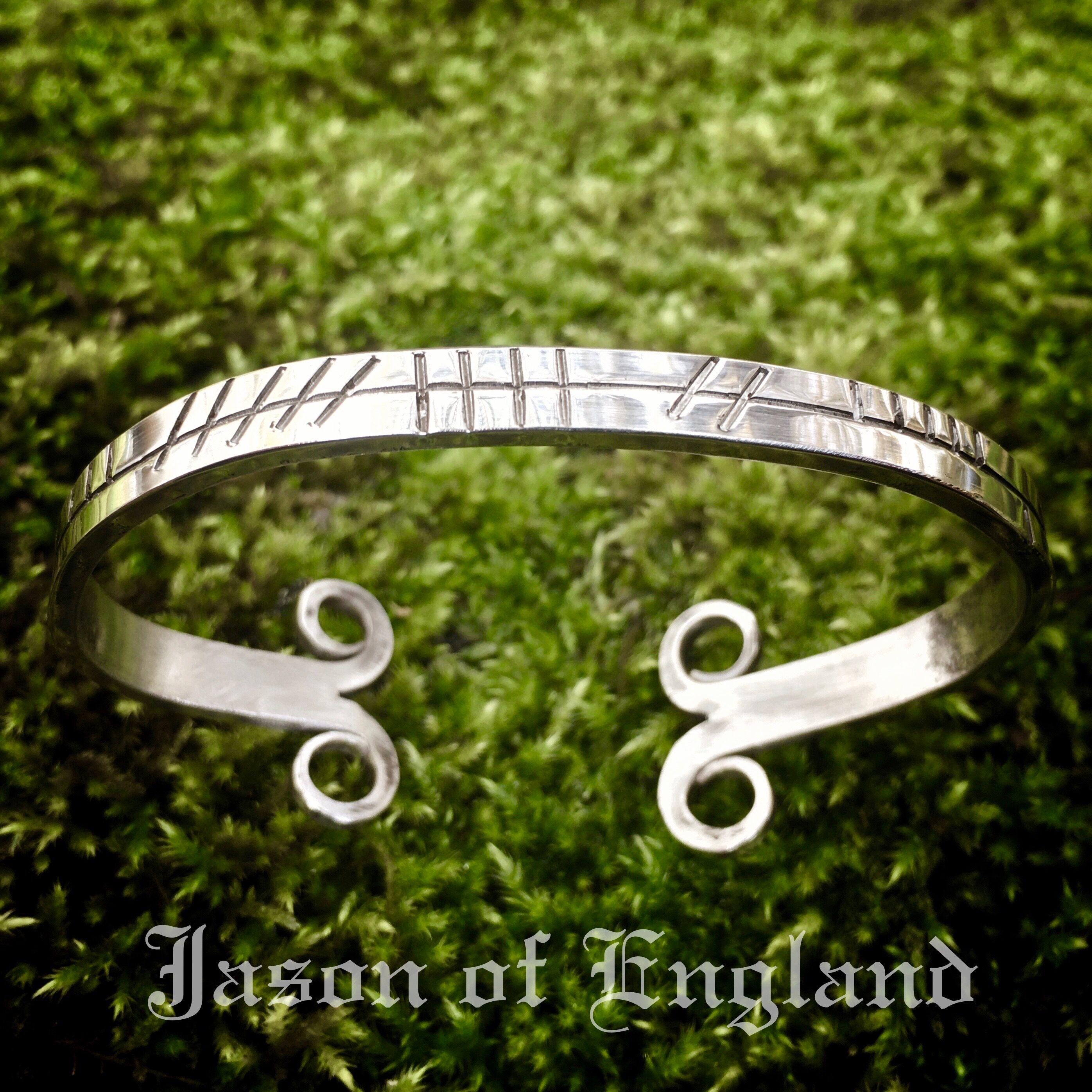 Druidic Ogham bangle.. Each set of lines represents the magical attributes of a particular Tree. Combined they make a spell, either to guide and create a situation or to attract whatever is required. Contact me to have one made especially for you.. The design of the bangle is inspired by Stav Kirke doors I saw in Norway... contact@jasonofengland.co.uk www.jasonofengland.co.uk #jasonofengland #ogham #druids #celtic #celticjewellery #celticjewelry #stavkirke