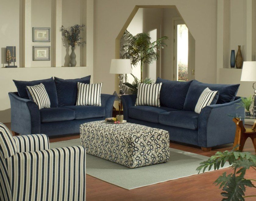 simple living room design featuring dark blue velvet couches with