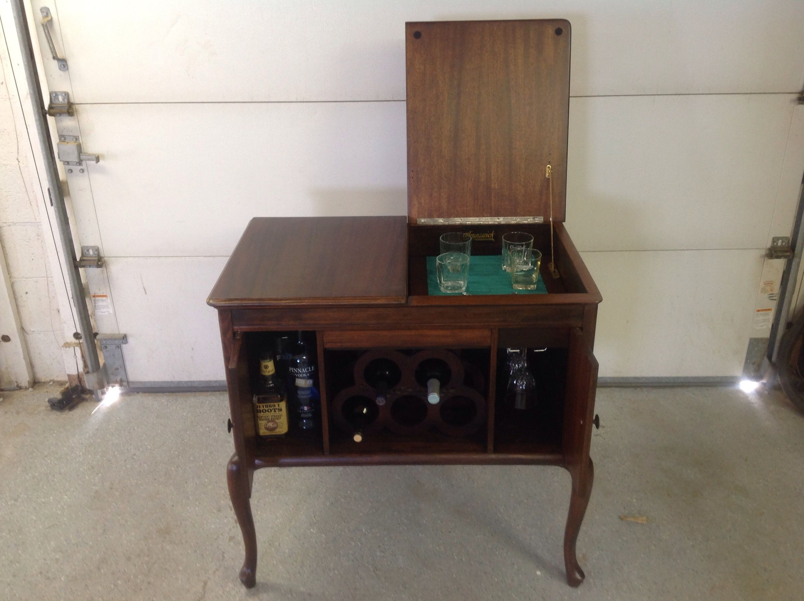 Repurposed Brunswick Victrola Cabinet To A Wine/ Liquor Cabinet.