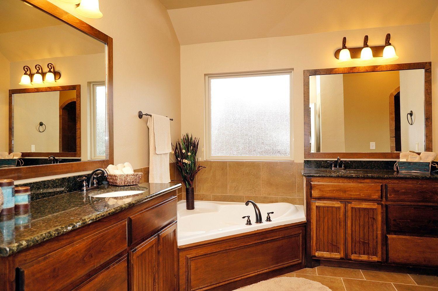 Master Bathroom with Corner Jet Tub Double Vanity Granite