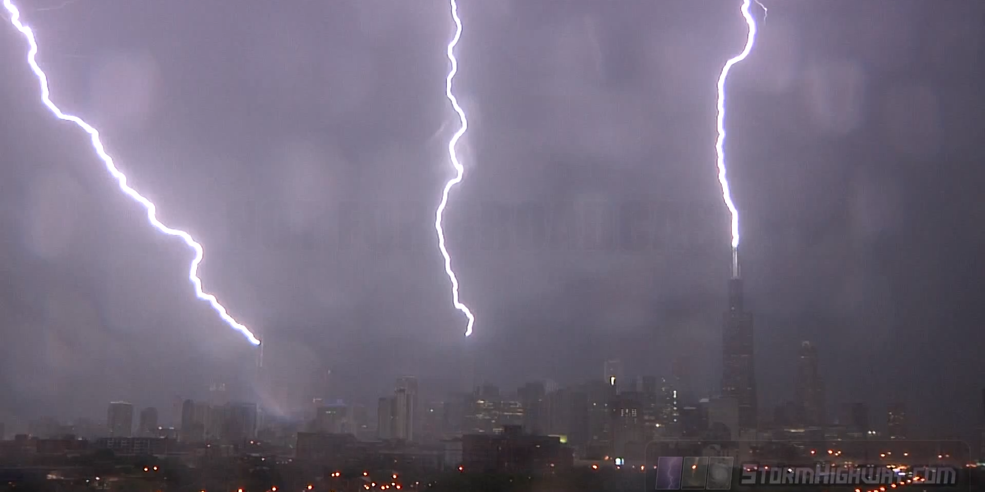 Insane Lighting Storm Hits Three Iconic Chicago Towers At Once Via DailyMail, by stormchaser Dan Robinson / YouTube