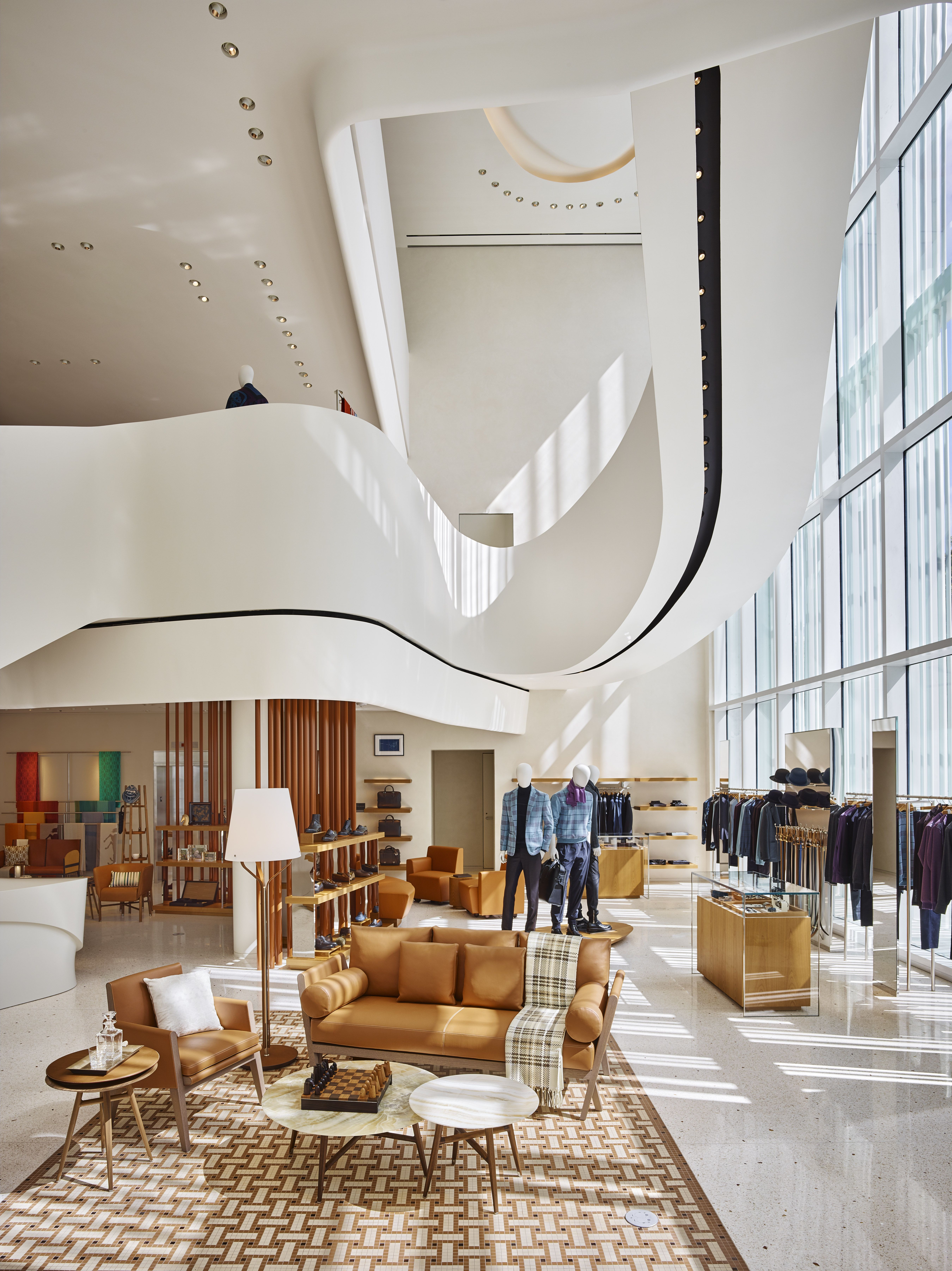 A terrazzo and plaster staircase swoops dramatically through the center of hermèss new miami design district flagship read on for more information about