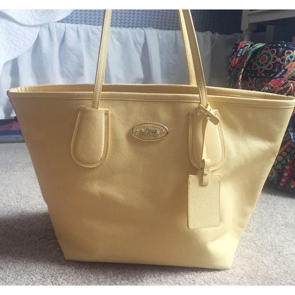 COACH purse Pastel yellow coach purse. Shoulder bag. Worn a couple of times. I find myself carrying a wallet and I never carry a purse. Very beautiful. Perfect for spring and summer! No scratches rips or stains. Flawless. Open to reasonable offers only. No trades. Coach Bags Shoulder Bags