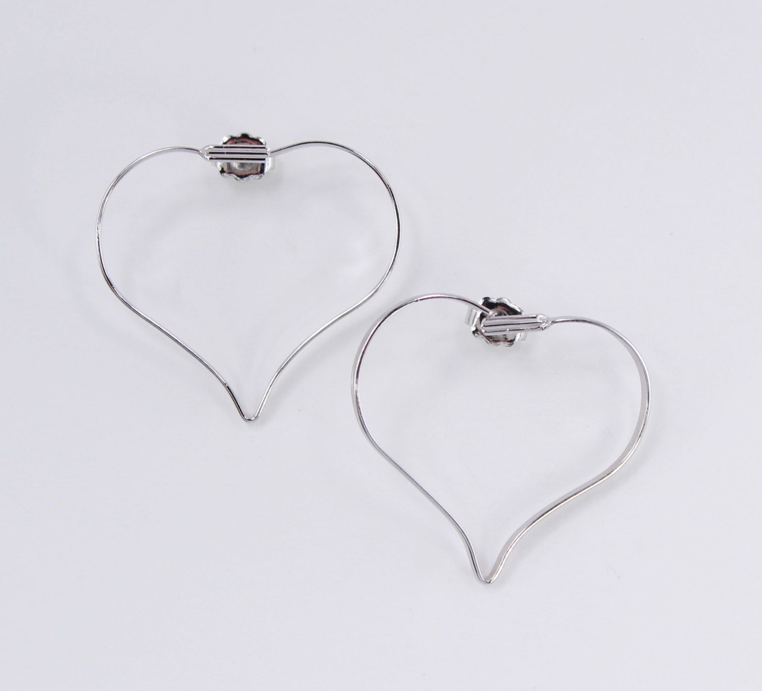 Vintage 1977 Signed Avon Touchpoints Silvertone Large Thin Metal Heart Hoop Minimalist Silver Tone Pierced Earrings Original Box NIB by ThePaisleyUnicorn on Etsy