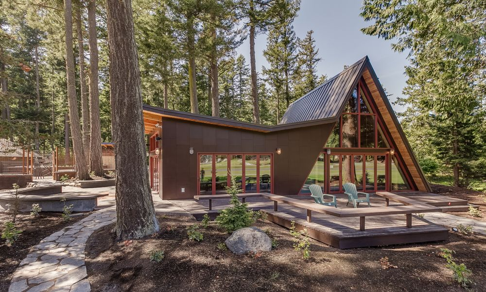 Exterior rain screen system of parflex has been added to a for Cabin addition floor plans