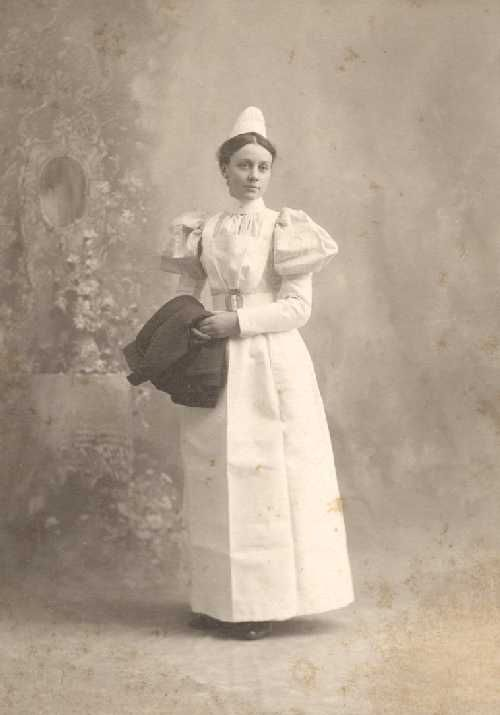 """""""Portrait of a Student Nurse, 1889."""" Portrait of Nurse maybe - a student nurse at the Pennsylvania Hospital School of Nursing. Nurse maybe is wearing the traditional uniform for Pennsylvania Hospital nursing students in the 19th Century, and holds the uniform cape in her arms."""
