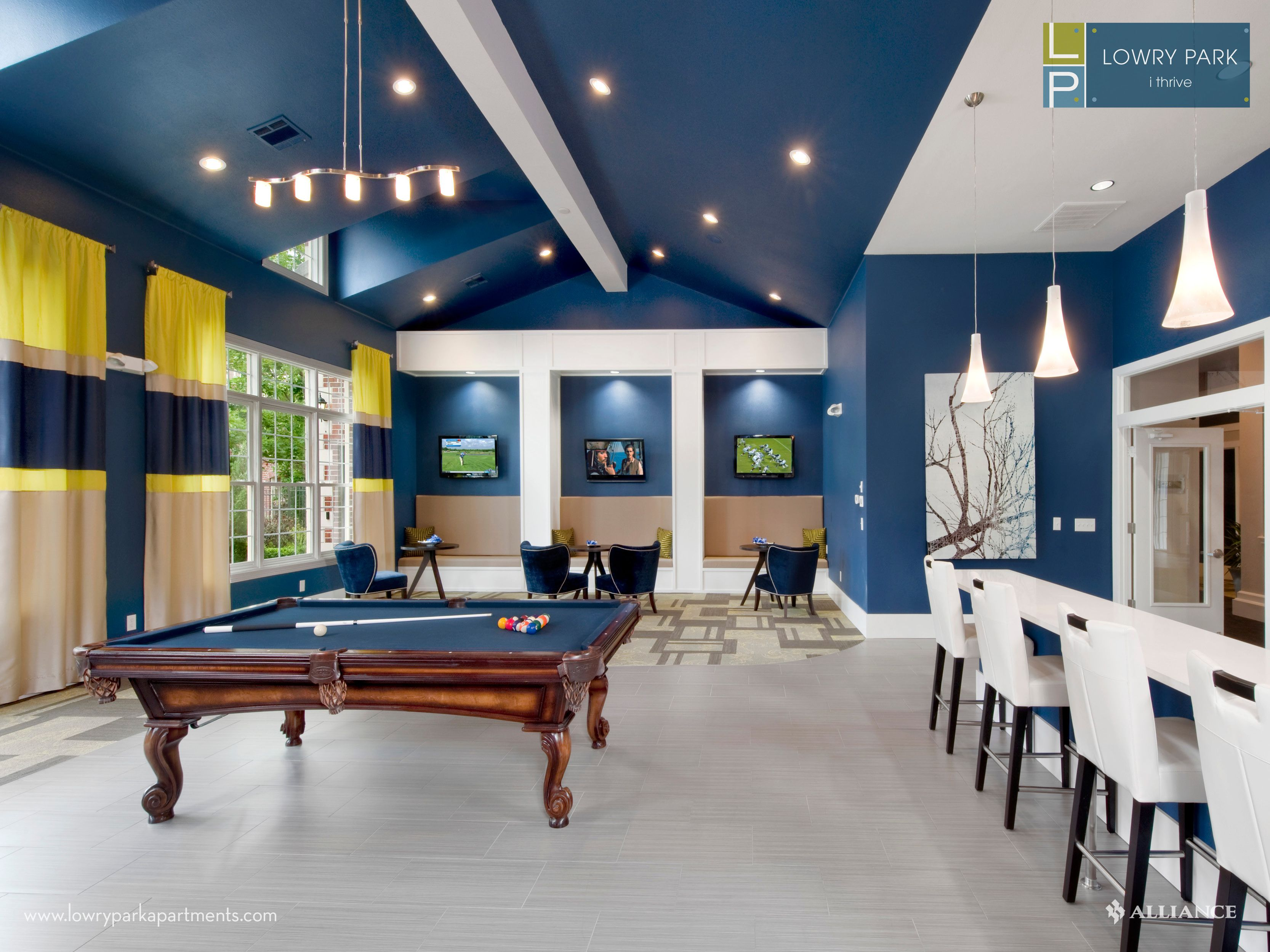 Clubhouse with billiards table at Lowry Park Apartments in