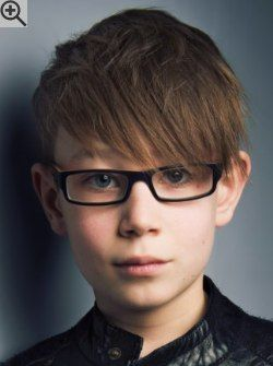 Modern Haircut For Boys With Glasses Featuring Short Sides