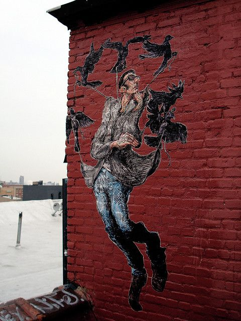 Icarus, woodcut and acrylic paint on paper pasted on wall by guerrilla muralist Elbow-Toe