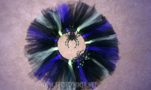 I love wreaths for any occasion! I was going through my craft stuff and came across black, purple and lime green tulle, I knew I had to make a wreath with it…since my daughter has outgrown t…