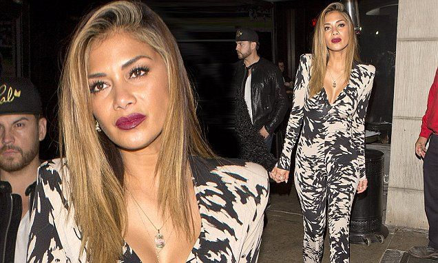 Nicole Scherzinger shows Lewis what he's missing in plunging jumpsuit