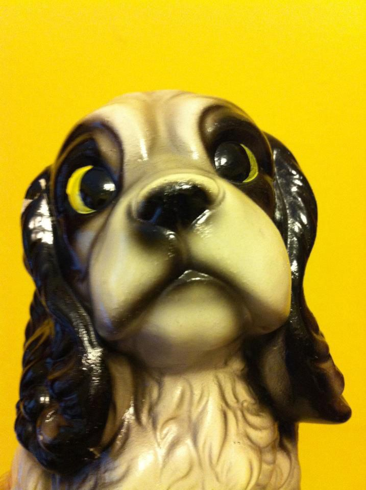 I picked this cross-eyed dog statue up at an antique mall today. How could you resist those crossed yellow eyes?