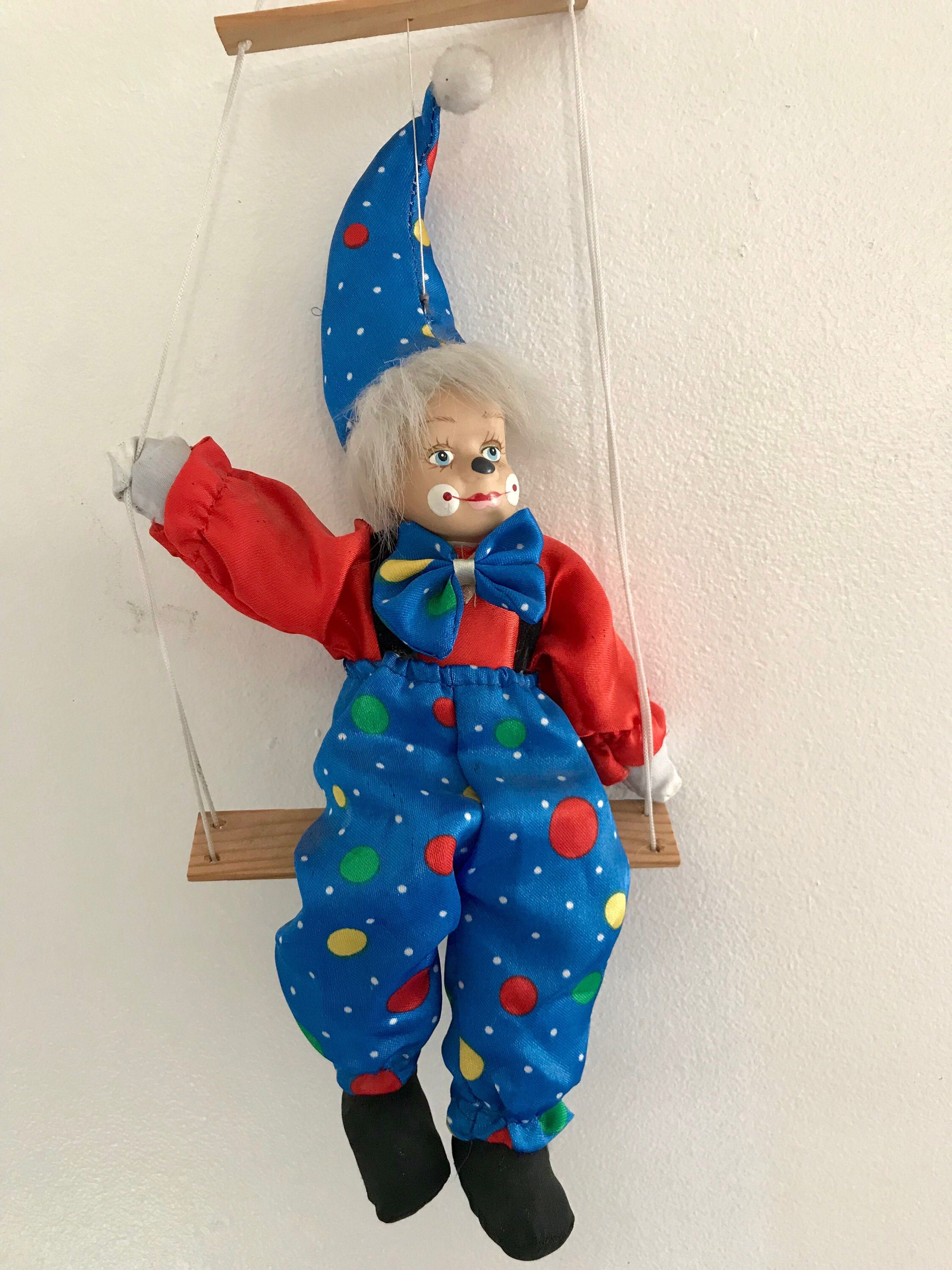 Clown sitting in swing Vintage Toy doll Marionette Puppet