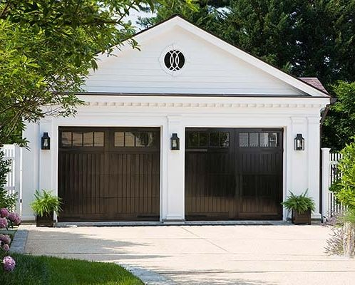 9 Surprising Ways To Decorate With Black Modern Garage Doors Garage Door Design House Exterior