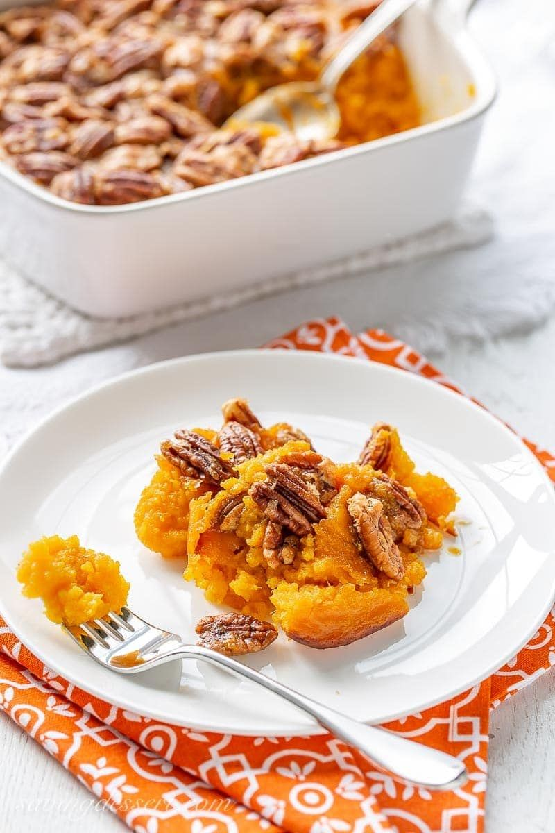Butternut squash casserole - the essential holiday side dish terrific served withroasted meats and poultry. A trusted family recipe for generations. #butternut #butternutsquash #butternutsquashcasserole #sweetpotatocasserole #thanksgiving #thanksgivingsidedish #easysidedish #christmasdinner #holidaysidedish #squashcasserole