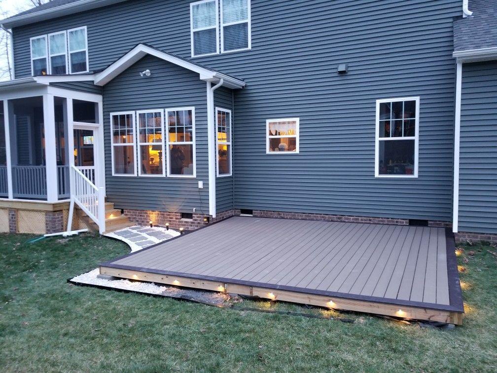 Diy ground level composite deck. Led lighting. Stone ... on Ground Level Patio Ideas id=37280