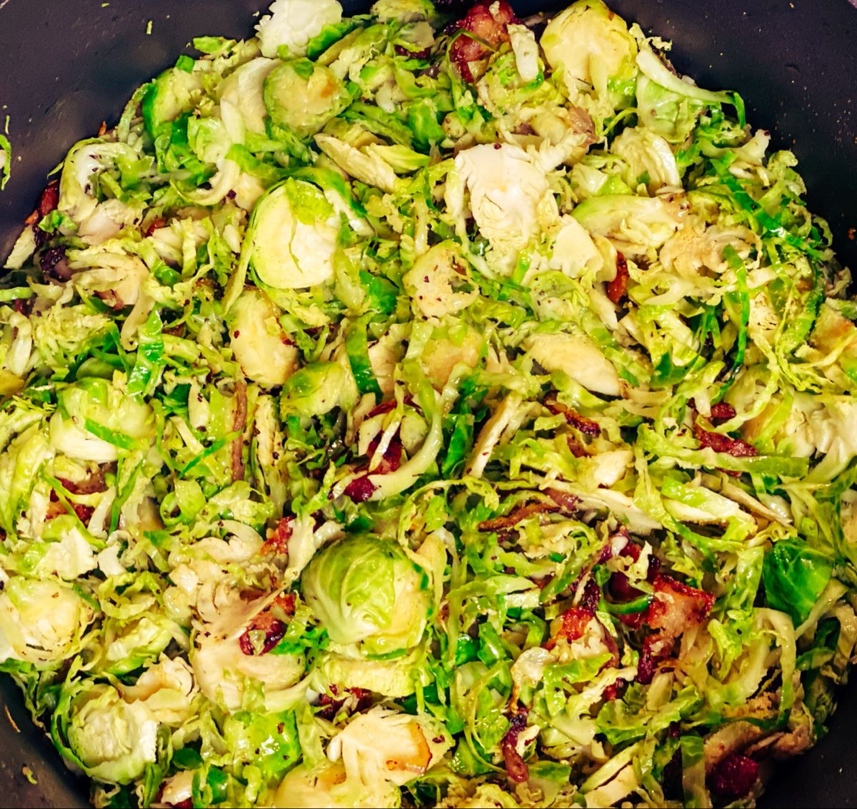Sautéd Shredded Brussels Sprouts...No Really #supergood Greg Reilly #style Brussels Sprouts Shredded, Shallots, Garlic Olive Oil, Bacon, Splash of Balsamic Vinegar! That's it #easyrecipes #eatyourveggies #tasty #greens #homecooked