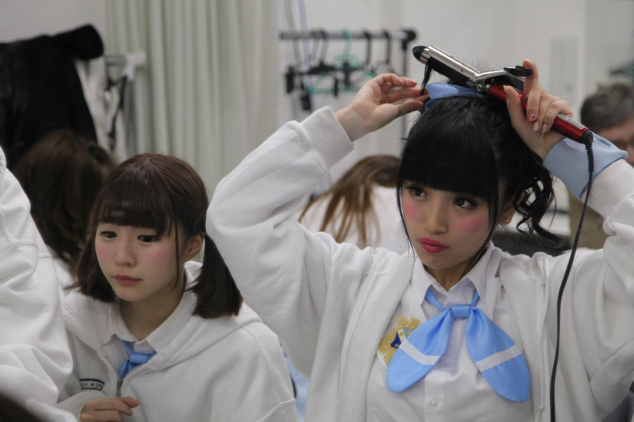Girls in a JK band in Tokyo prepare for their performance. (VICE News)