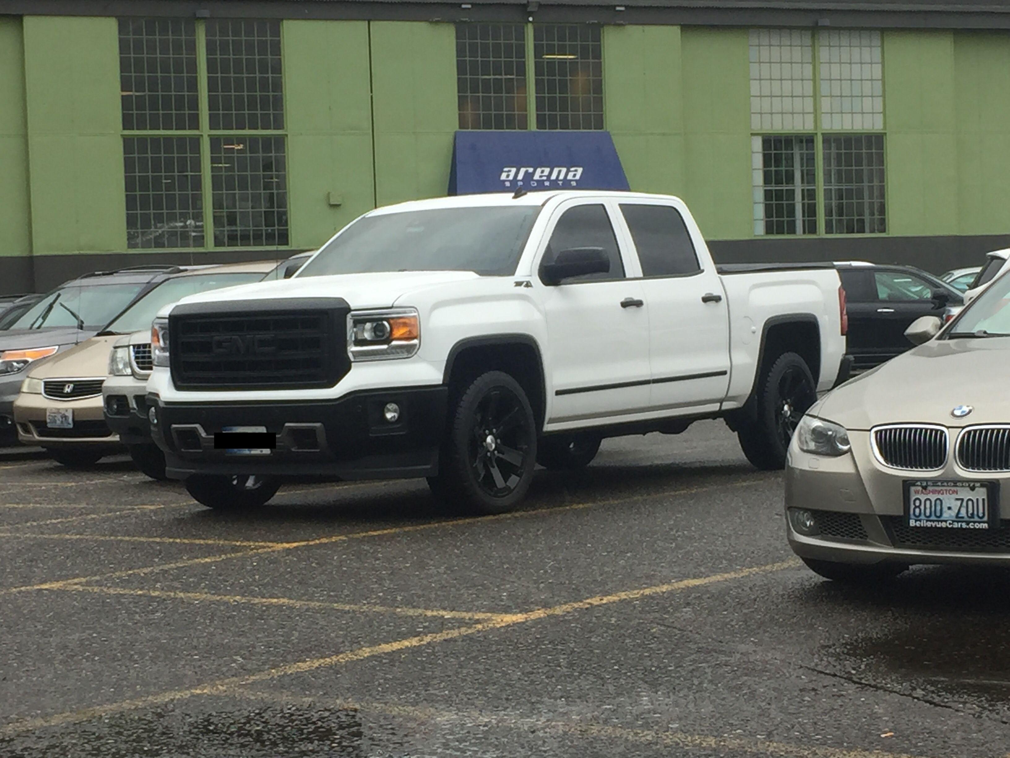 Murdered our gmc sierra 1500 with black 22 inch gmc wheels blacked out grille sierra 1500door handlesbadgestruckswheels