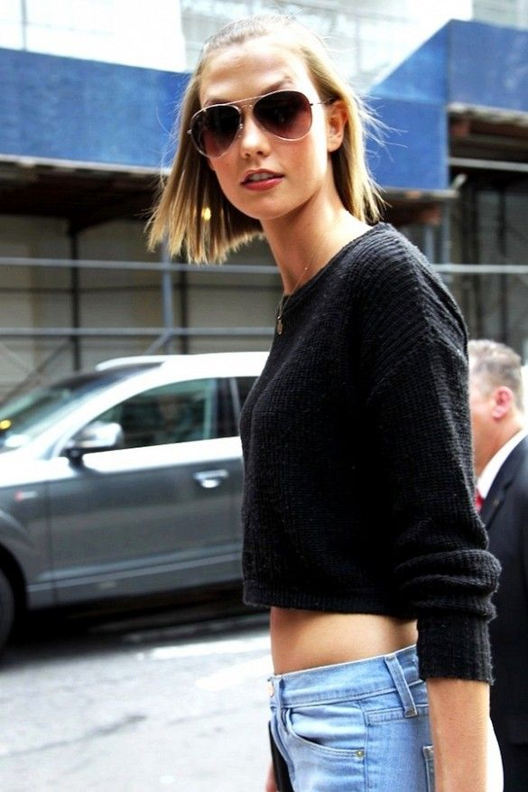 Karlie Kloss wears a cropped black sweater with aviator sunglasses | @andwhatelse