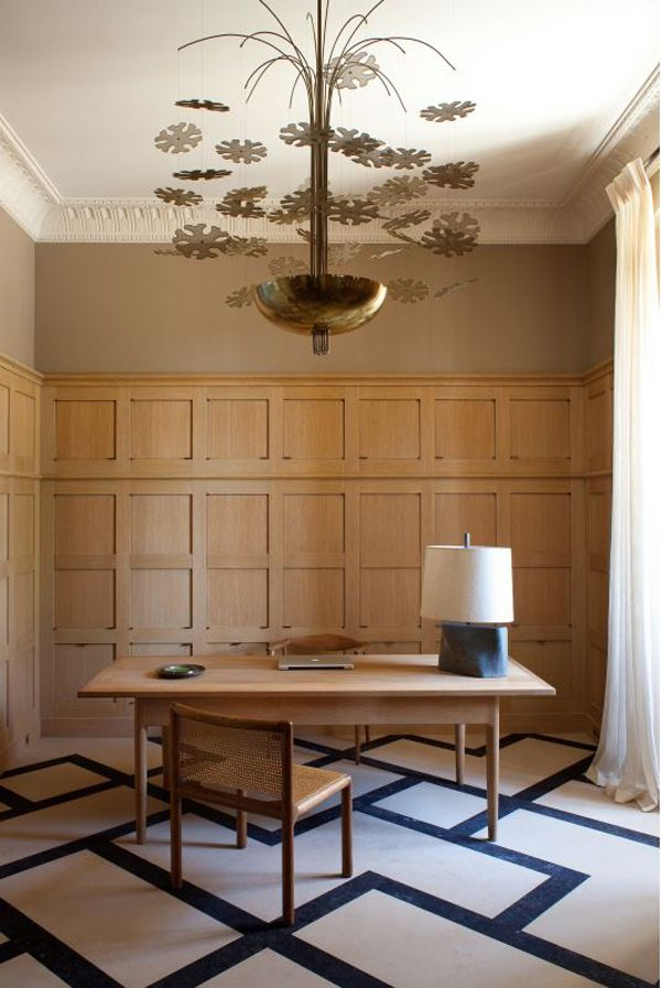 A wood paneled office, complete with graphic floor pattern, in a Château in Provence. Design by Pierre Yovanovitch.